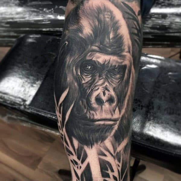 Gorilla Mens Tattoo In Woods On Mans Leg