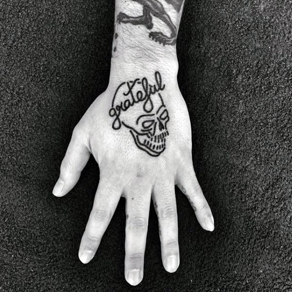 Grateful Lettering With Skull Mens Simple Hand Tattoos