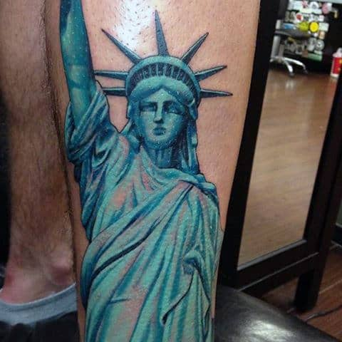 11 statue of liberty tattoos that every american will appreciate. Black Bedroom Furniture Sets. Home Design Ideas