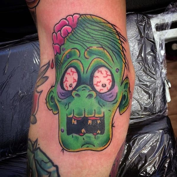 Green Faced Zombie Mens Cartoon Style Bicep Tattoo Inspiration