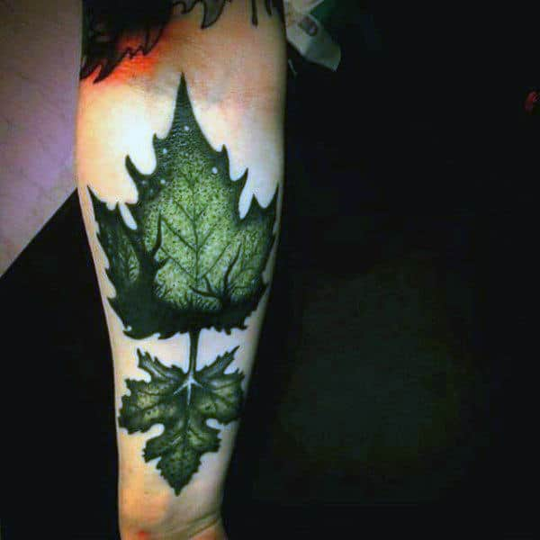Green Mens Leaf Tattoo With Deer In Background On Arm
