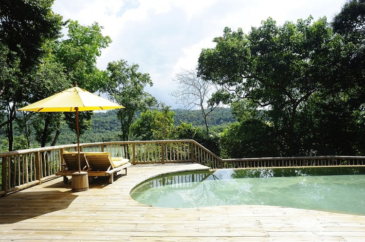 Green Resort Above Ground Pool Wood Deck