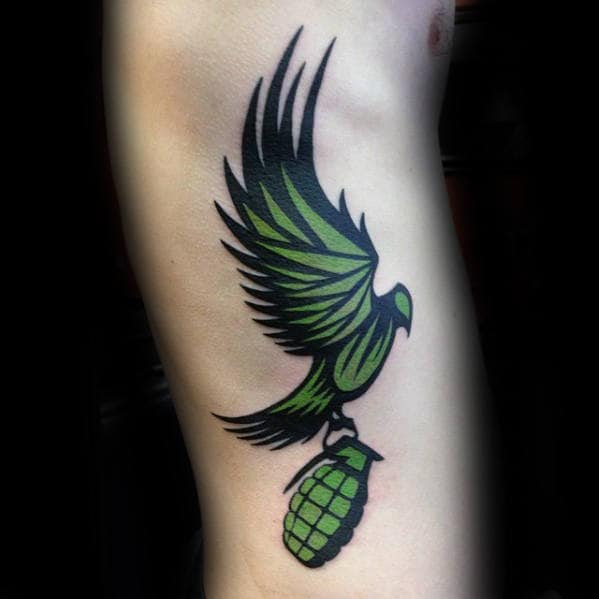 Green Tribal Bird Flying With Grenade Mens Rib Cage Side Tattoo