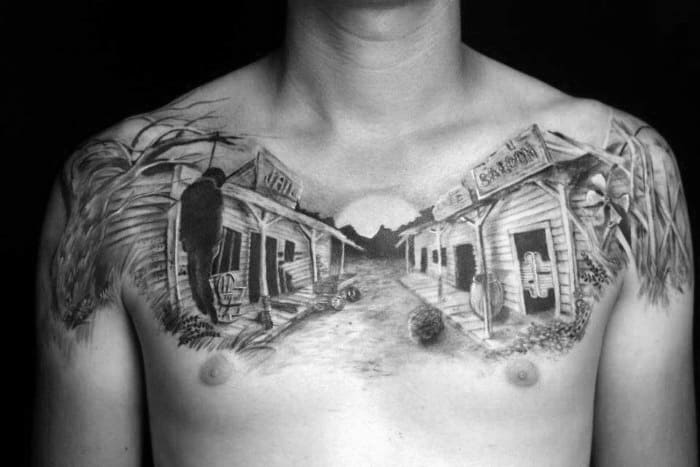 Grey And Black Chest Piece Tattoo On Man Western Scene Saloon Bank
