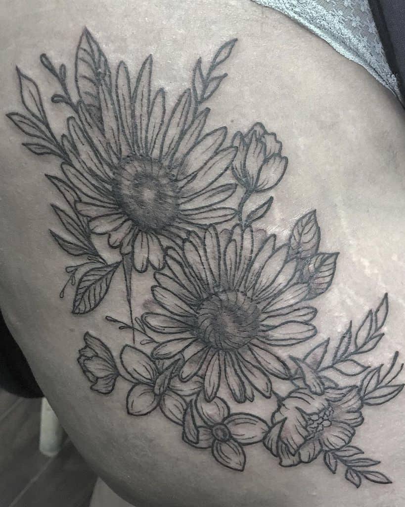 Thigh tattoo black and grey daisy flower bouquet