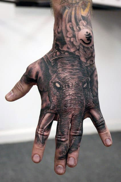 Grey Elephant Head And OM Tattoo Male Hands