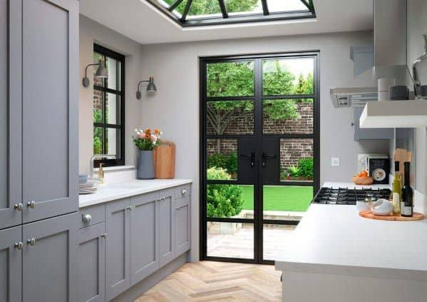 Grey Kitchen With Glass Doors And Skylight Ceiling