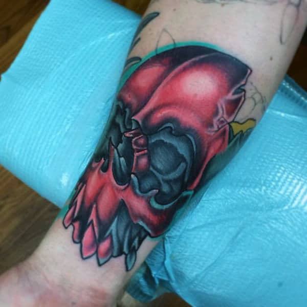 Grey Red Skull New School Tattoo Male Forearms