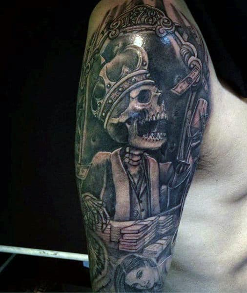 Grey Skeleton With Crown Tattoo Upperarms For Guys