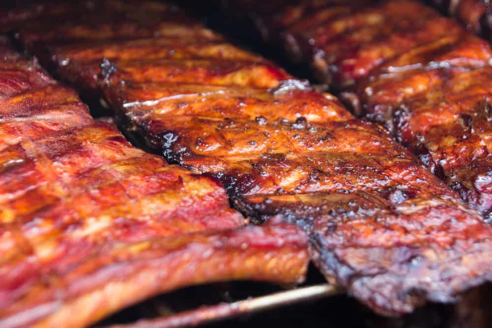 focus of grilled ribs inside the smoker