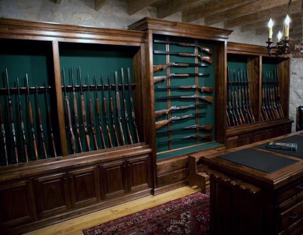 Gun Collector Room With Rifles And Shotguns Mounted On Wall Rack