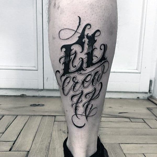 Guy Ankle Black Lettering Tattoo