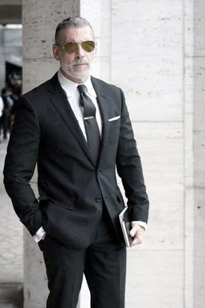 Guy Black Suit Style With Black Tie And Tie Bar