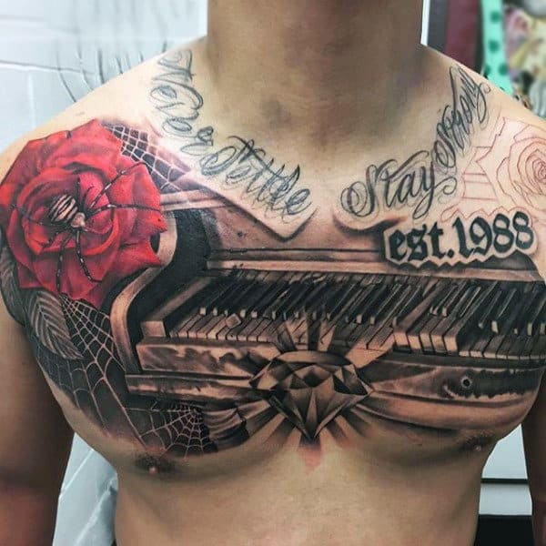 Guy Glowing Diamond On Piano And Spider Tattoo On Upper Torso