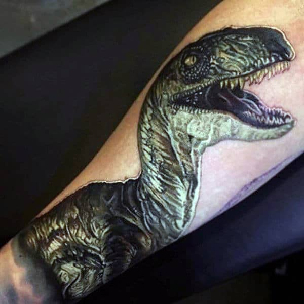 Guy With 3D Dinosaur Tattoo On Forearms