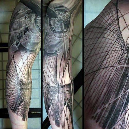 Guy With 3d Brooklyn Bridge Tattoo Design Sleeve