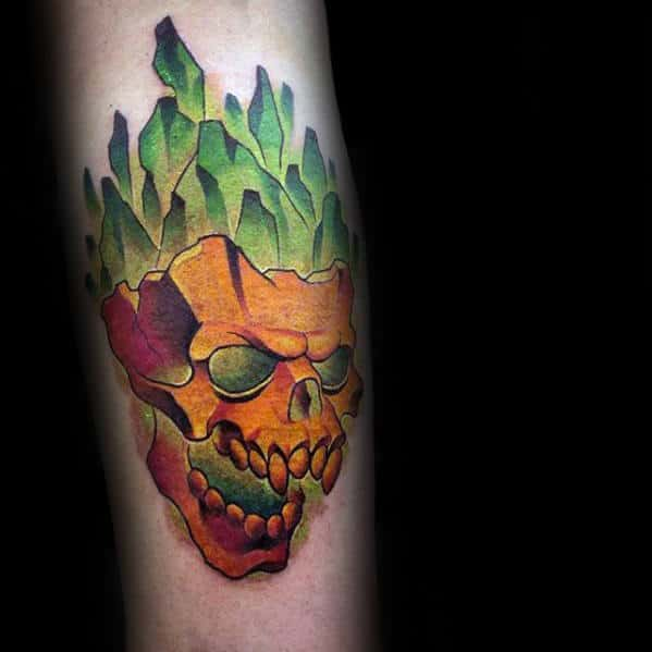 Guy With 3d Colorful Glowing Green Orange Skull Tattoo On Arm