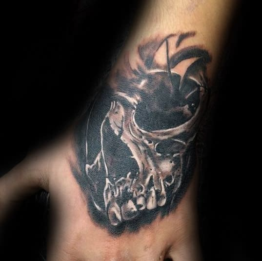 Guy With 3d Cool Skull Tattoo Design On Hand