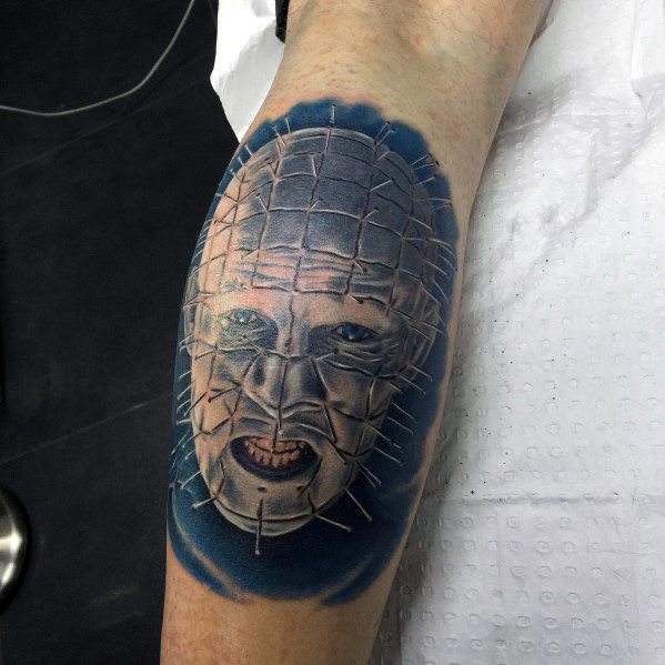 Guy With 3d Hellraiser Tattoo On Leg Calf