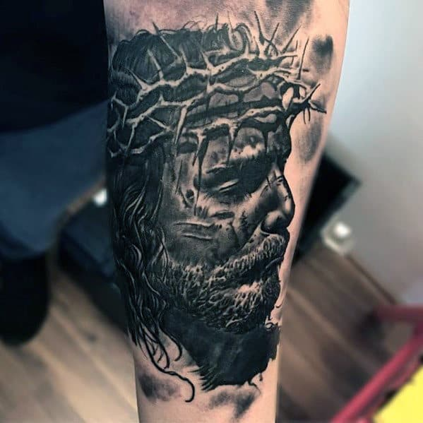 Guy With 3d Jesus Face Tattoo On Inner Forearm