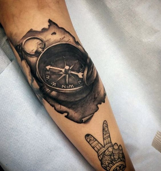 Guy With 3d Nautical Compass Tattoo On Forearm