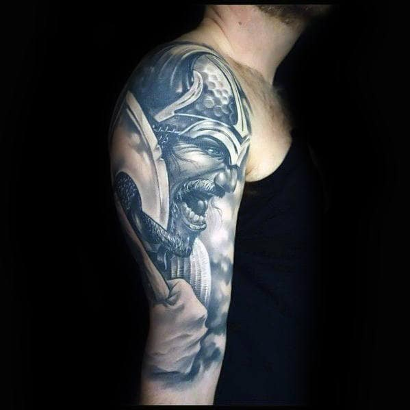 Guy With 3d Viking Realistic Tattoo Deisgn On Arm