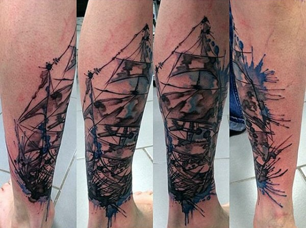Guy With Abstract Watercolor Tattoo On Calves