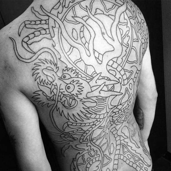 Guy With Amazing Full Back Black Ink Outline Traditional Dragon Themed Tattoo