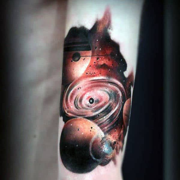 Guy With Amber Colored Universe Tattoo On Forearms