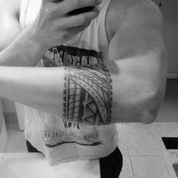 Guy With Armband Tribal Design Tattoo