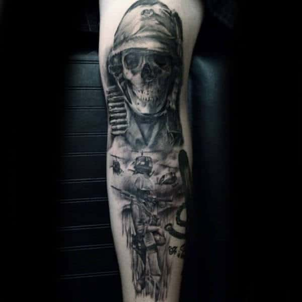 Guy With Armed Themed Leg Tattoo Skull Design