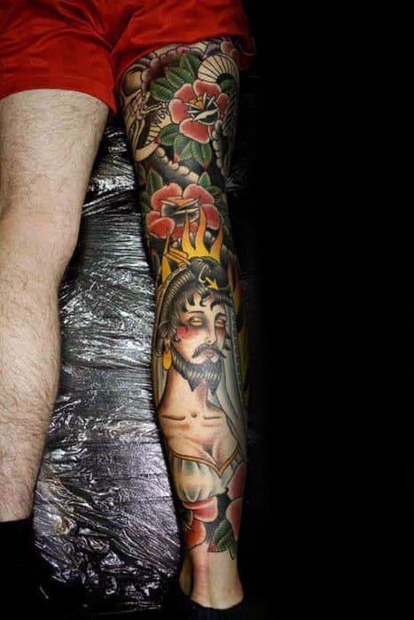 Guy With Awesome Traditional Leg Sleeve Tattoo Design