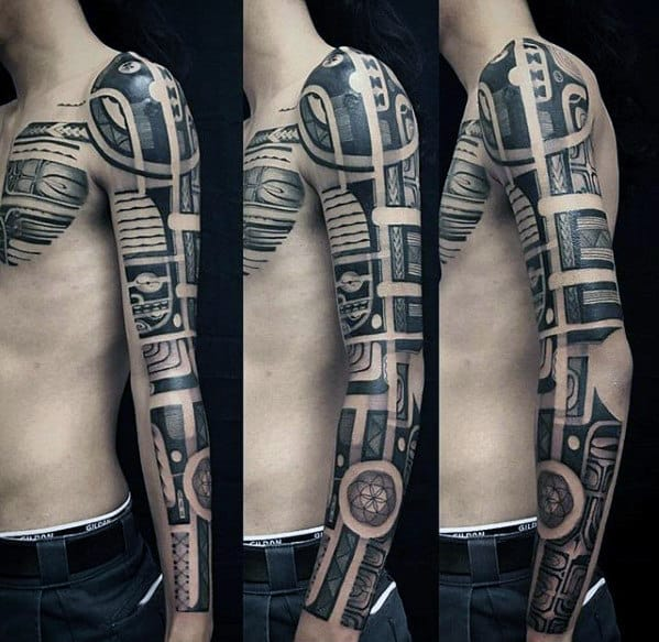 Guy With Awesome Tribal Full Arm Sleeve Tattoo