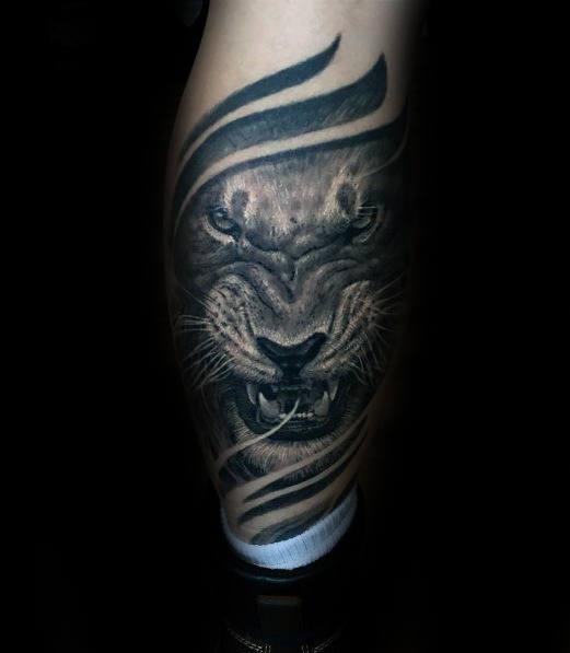 Guy With Back Of Leg Agressive Lion Tattoo