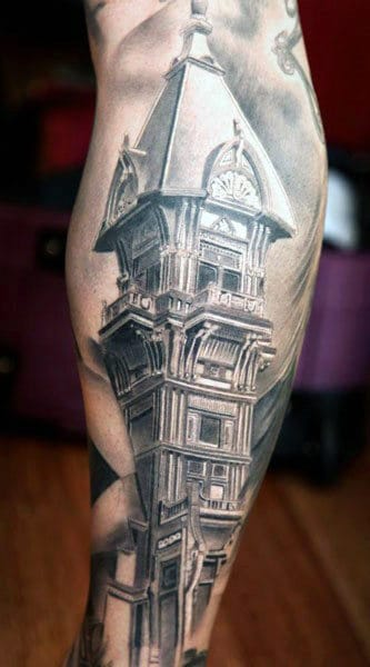 Guy With Back Of Leg Building Tattoo