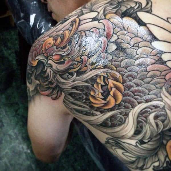 Guy With Back Tattoo Of Mythological Phoenix Bird Design