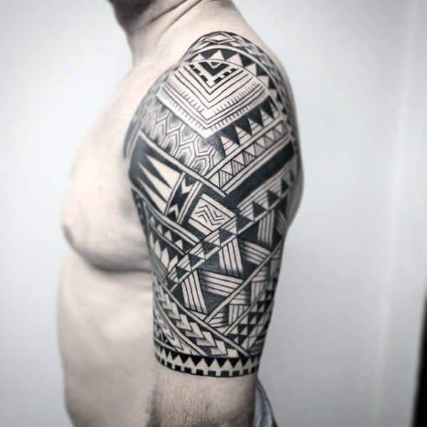 Guy With Badass Tribal Half Sleeve Detailed Pattern Tattoo Design