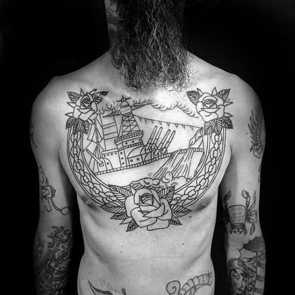 Guy With Battleship Tattoo Design On Chest