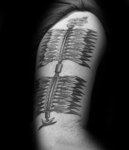 Guy With Black And Grey Ink Arrows Fsu Tattoo Design