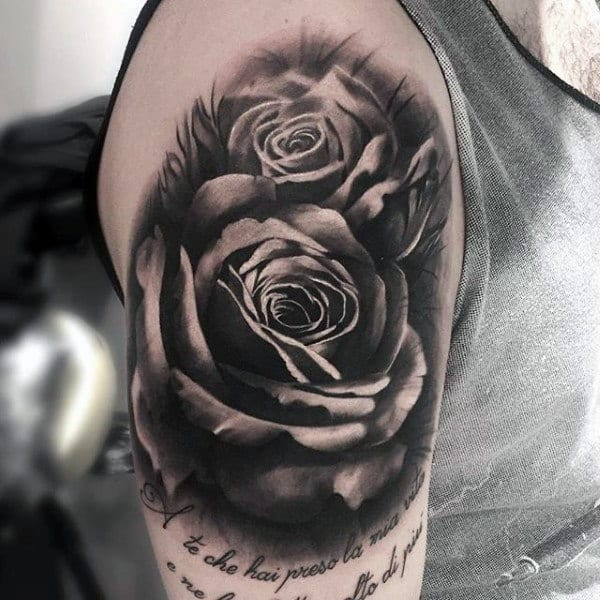 Guy With Black And Grey Pair Of Roses And Quotes Tattoo On Arms
