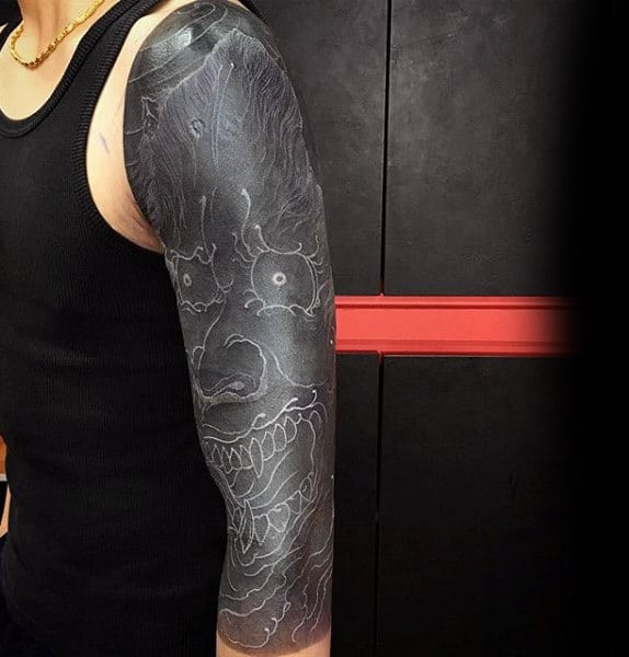 Guy With Black And White Evil Man Tattoo On Full Sleeves