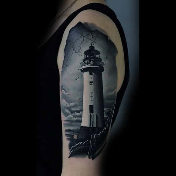 Guy With Black And White Lighthouse Tattoo On Upper Arms