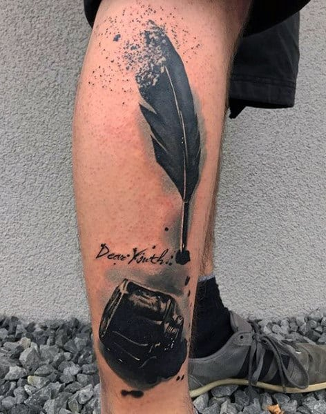 Guy With Black Feather Tattoo On Legs