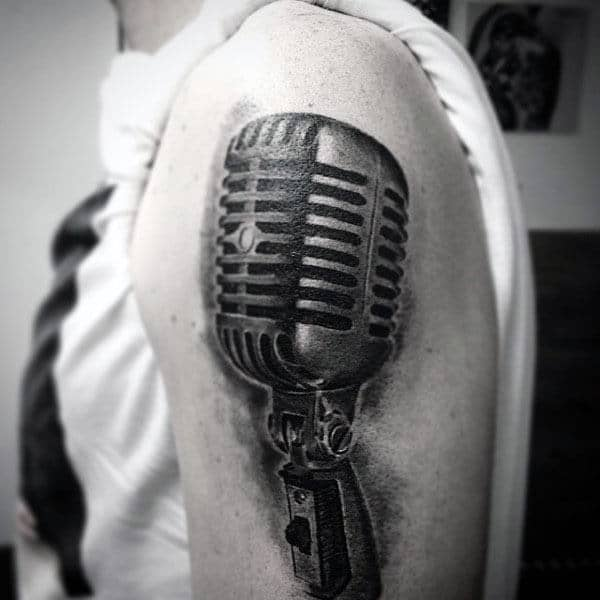 Guy With Black Shaded Microphone Tattoo On Arms