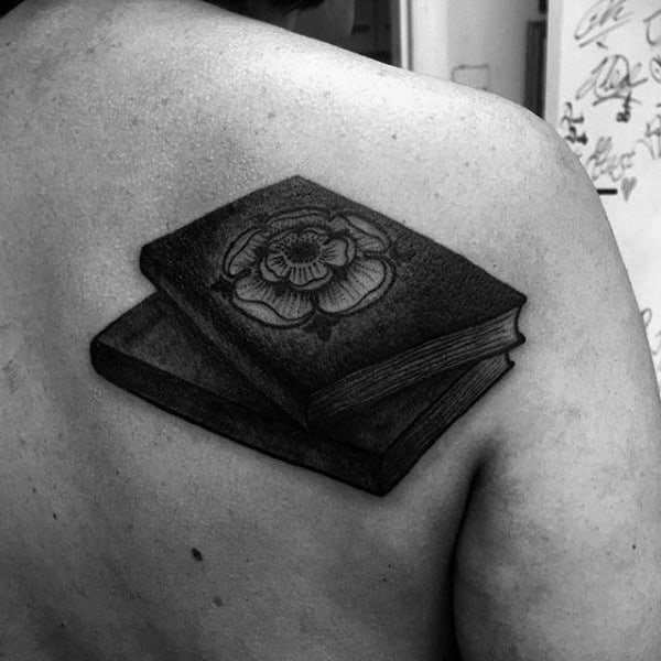 Guy With Blackish Grey Tattoo Of Books On Back
