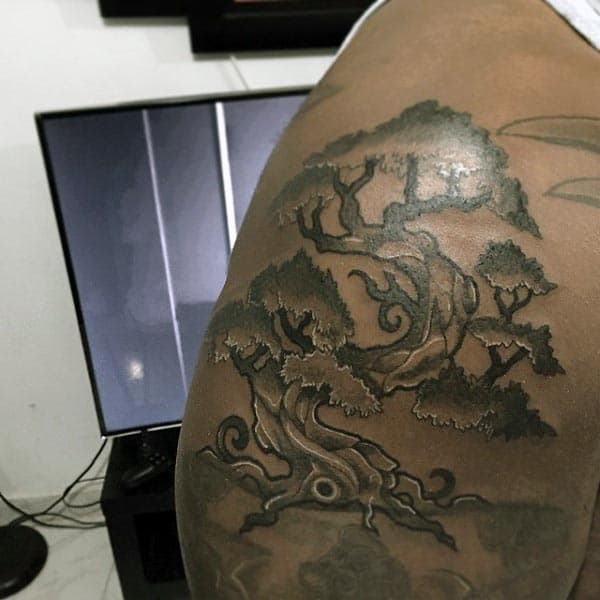 Guy With Bonsai Tree Upper Arm Tattoo Design