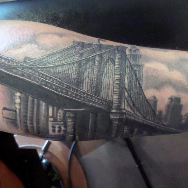 Guy With Brooklyn Bridge Forearm Tattoo