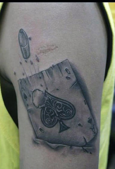 Guy With Bullet Piercing Through Ace Of Spades Tattoo Male Arms