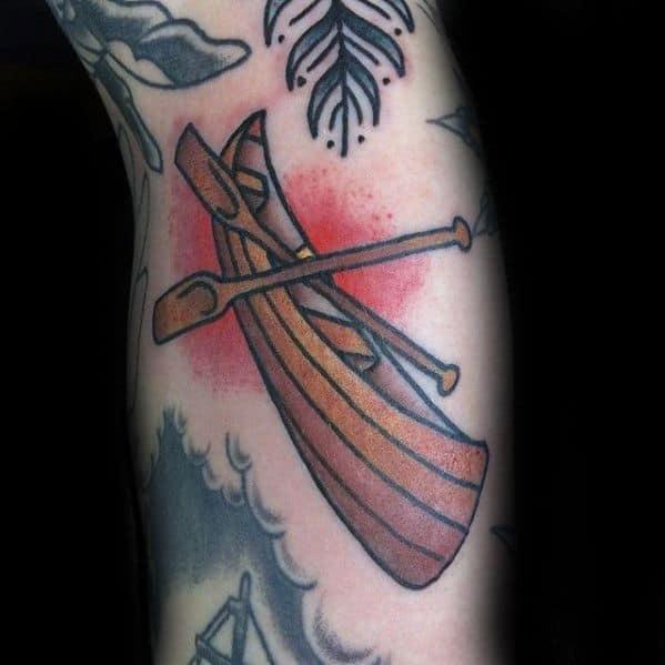Guy With Canoe Tattoo Design