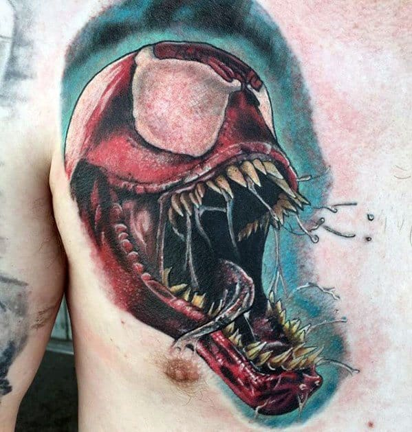 Guy With Carnage Tattoo Design On Chest